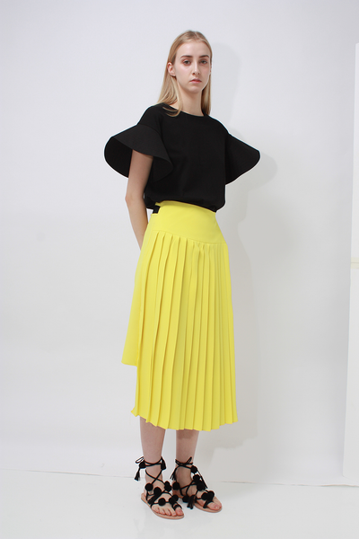 Alula Skirt in Peach/Yellow. Two-tone skirt from a contrasting combination of matte crepe and bright bold color.