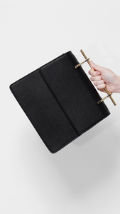 amor needle black bag with gold details