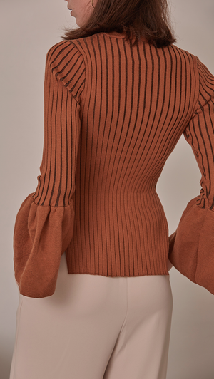 Etre Sweater in Brown. Oversized puffs on exaggerated cuffs, rib knit in the avant-grade silhouette. Voluminous bell sleeves in cropped length top with side slit. Rounded hem. Super soft feel. Designed to skim the body. The slim fit makes it a natural for laye