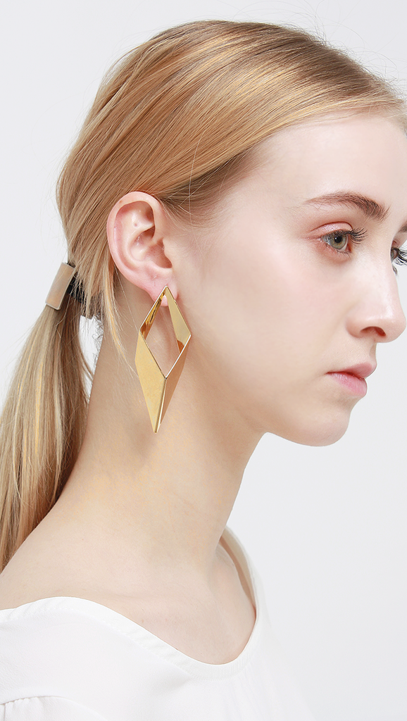 Swirl Earring in Petal gold earrings.