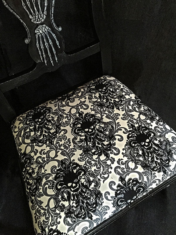 Seat cushion fabric has fabulous skull details.