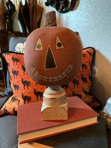 Primitive Jack O'Lantern on a pedestal