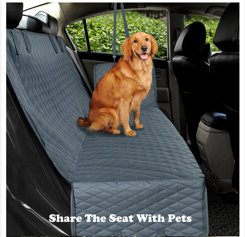 A dog sitting inside the car using FactPet™ Waterproof Back Seat Dog Cover Hammock For Car
