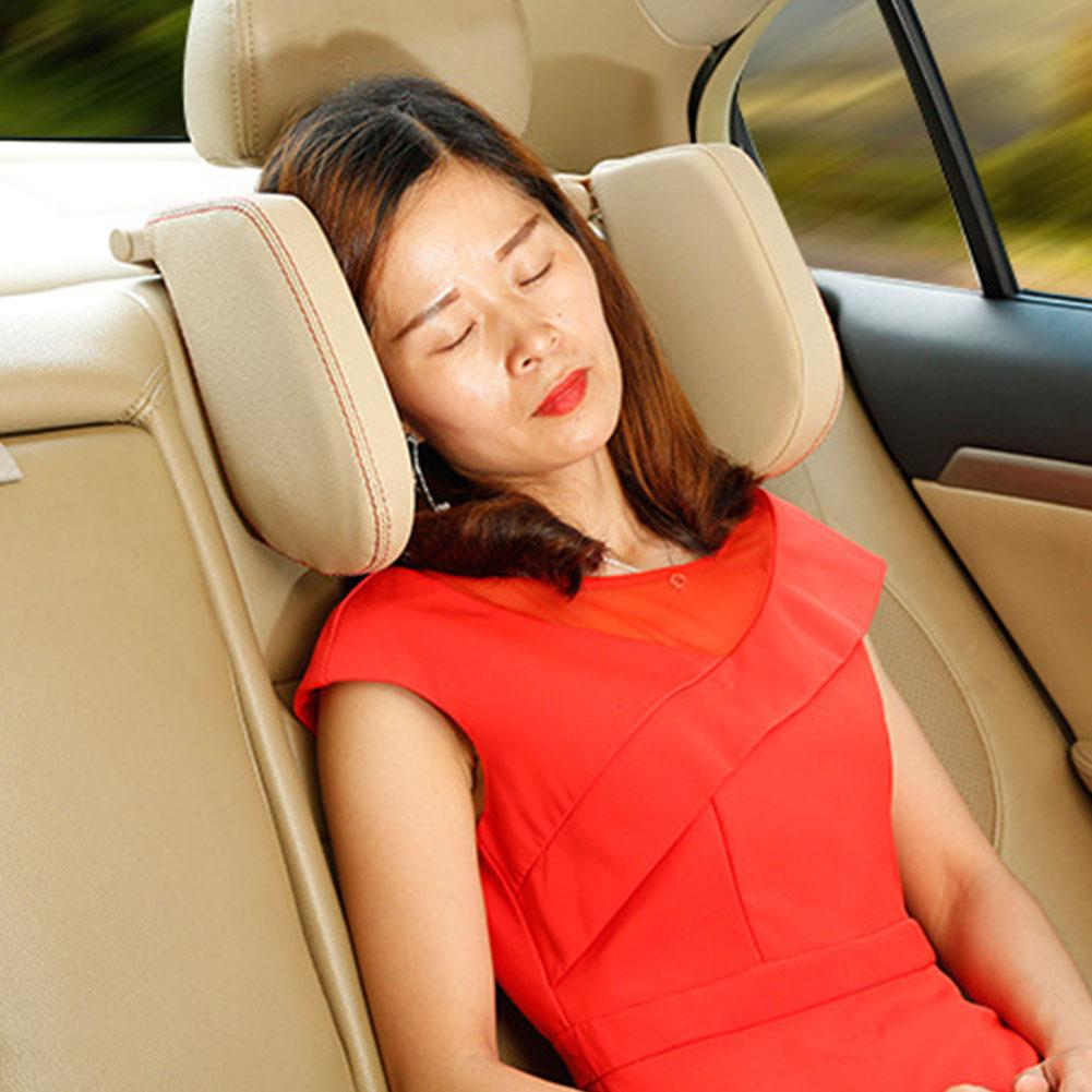 A woman sleeping inside a car using the FactCare™ Adjustable Car Seat Headrest Travel Neck Pillow Support