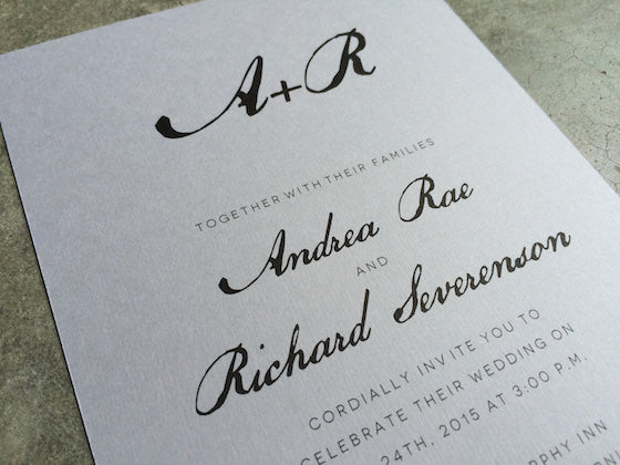 printable black and white calligraphy style wedding invitation printed on light gray paper.