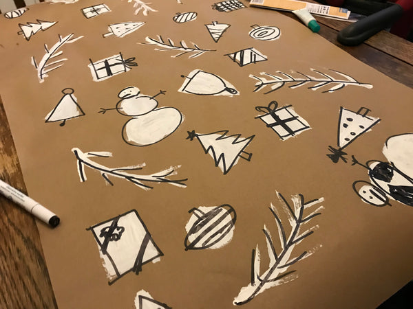DIY wrapping paper using white acrylic paint, packing paper and a sharpie