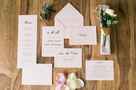 e.m.papers Calligraphy Monogram Wedding Invitation Set on  light pink paper