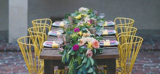 bright wedding table with yellow chairs