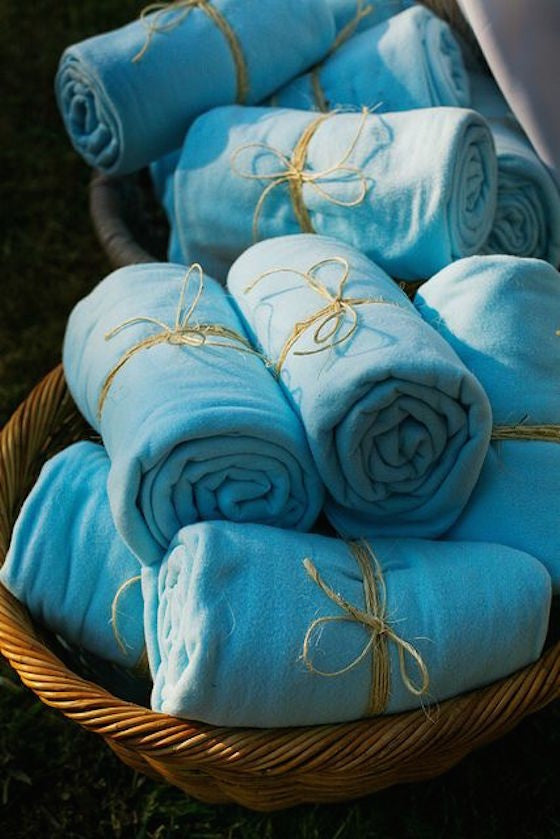 Summer blankets for an backyard wedding