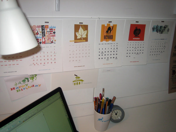 e.m.papers desk with printable calendar