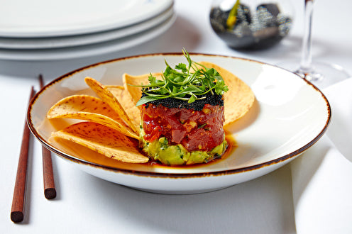 the spicy yellowfin tuna tartare with hass avocado, sweet chili, cucumber, red shiso and soy caviar—all served alongside taro chips.