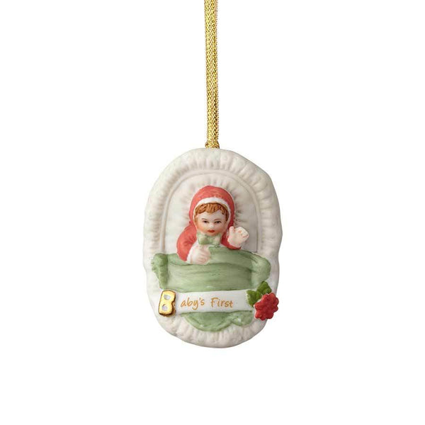 """Baby's First - Brunette Newborn"" porcelain ornament from the Growing Up Girls collection in giftable box.Showcases a brunette baby girl in a bassinet with golden accent and ""Baby's First"" message"