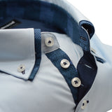 Men's light blue shirt with small navy double collar upclose