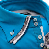Men's turquoise shirt with black and white triple collar upclose