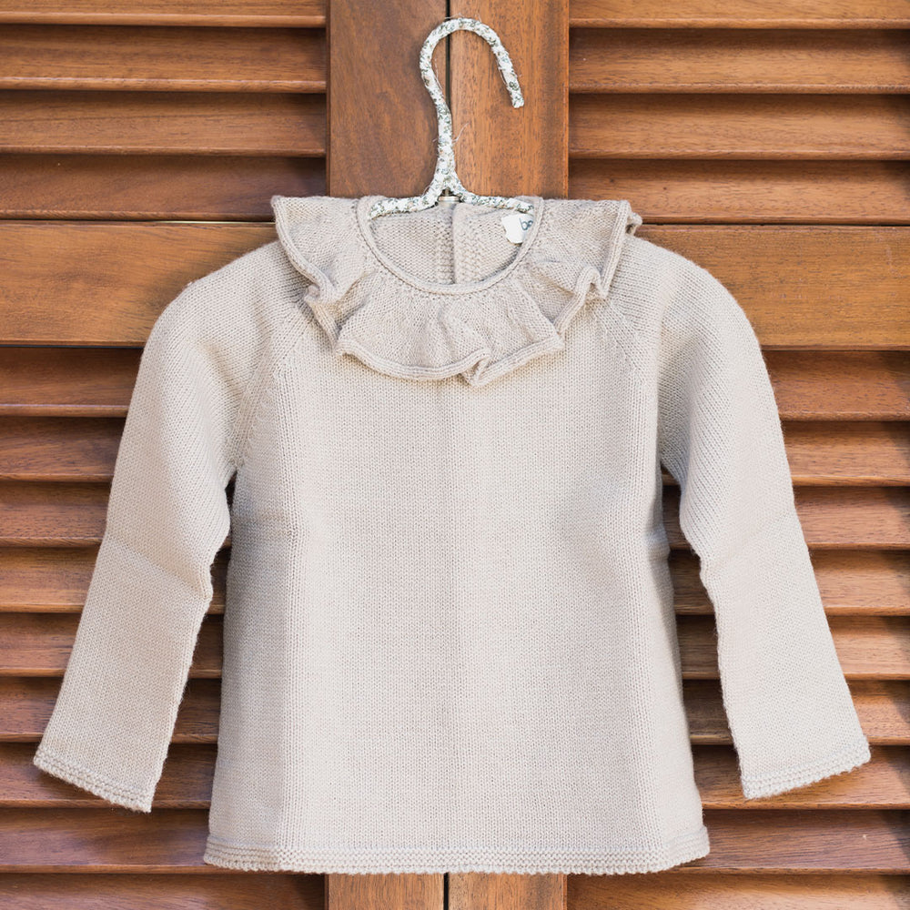 Knitted pullover with ruffled neck