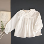 White blouse with ruffled collar
