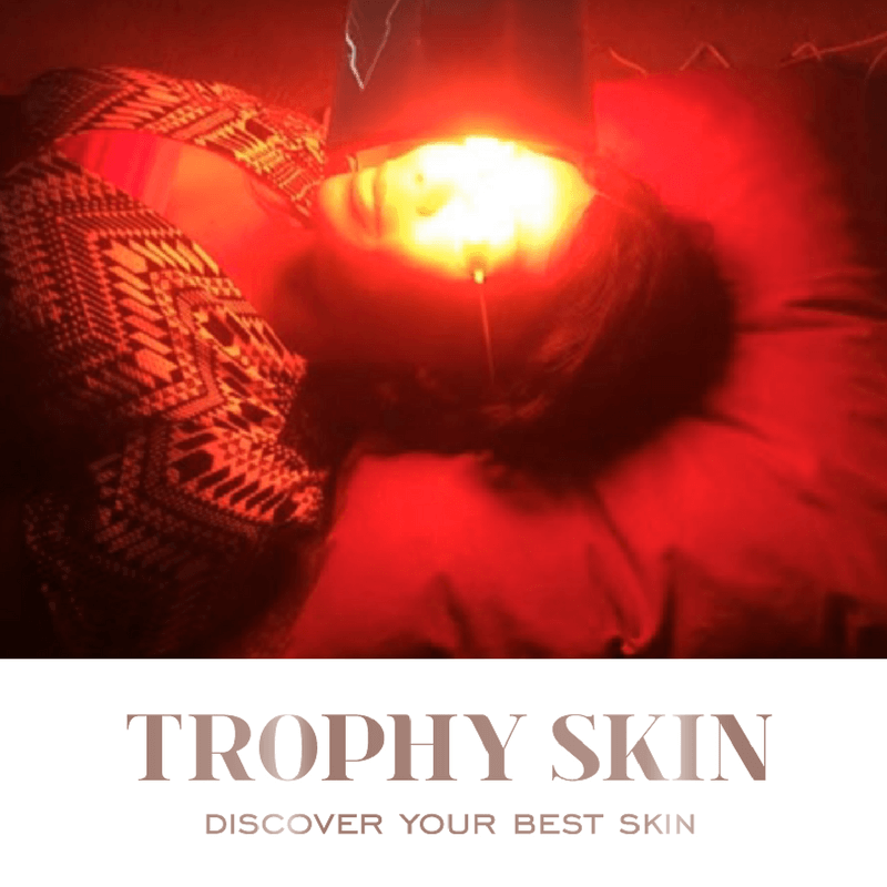 Woman using anti aging red light therapy lamp