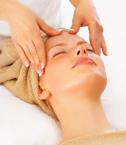 Woman having spa facial massage