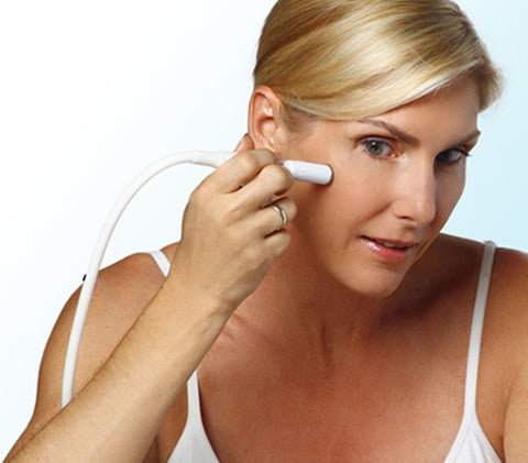 Woman doing microdermabrasion