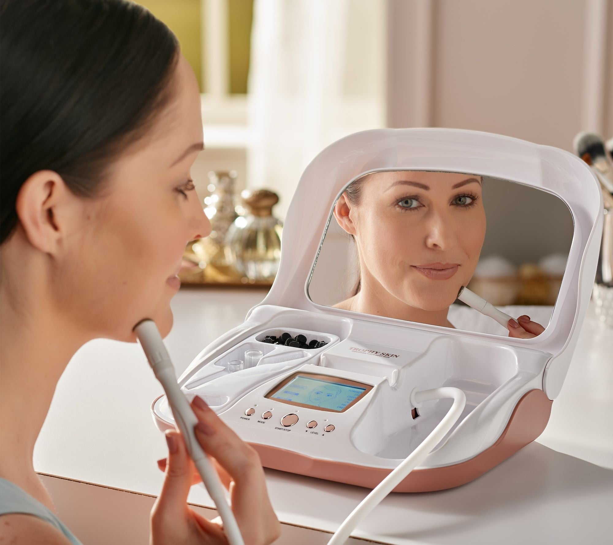 woman using microdermmd at home microderm
