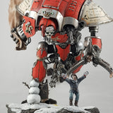"alt=""My fully painted Santa knight Christmas diorama, red imperial knight with Santa skull head. Sprinting towards the camera along a snowy rocky scene chasing after Johann the peasant. Swinging a massive sack full of presents towards a snowman"""