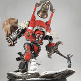 "alt=""My fully painted Santa knight Christmas diorama, red imperial knight with Santa skull head. Sprinting along a snowy rocky scene chasing after Johann the peasant. Swinging a massive sack full of presents towards a snowman. Armed with a war bell and combat claw """
