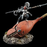 "alt=""example of a soul gem in use, shown on the forehead of a severed eldar titan head with a dark eldar figure standing atop"""