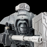 "alt=""imperial knight extermination cannon shown posed on an imperial knight, firing through the fire slots of a breach shield"""