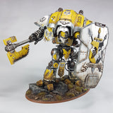 "alt=""painted yellow hawkshroud imperial knight with chain axe combat arm and heraldry breach shield"""