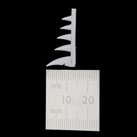 "alt=""scenic resin spikes shown measured next to a rulers, showing the tallest to be 12mm in height"""