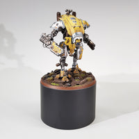 "alt=""one hundred millimetre round plinth shown with a painted yellow imperial knight armiger for scale reference"""