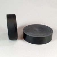 "alt=""two black resin round plinths showing the flattened off face on each"""
