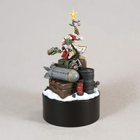"alt=""Round Black plinth with a painted red gobbo model standing on a pile of ammo crates"""