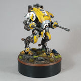 "alt=""painted yellow imperial knight armiger on a scenic base mounted on a one hundred millimetre plinth for reference"""