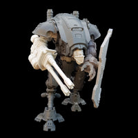 "alt=""imperial knight armiger model kit assembled with fist, shield and duel barrel auto-cannon. Shown from the right as it looks to its left ready to fire"""