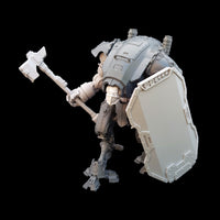 "alt=""imperial knight armiger model kit assembled with breach shield and combat fist carrying the power hammer. looking left and ready to strike"""