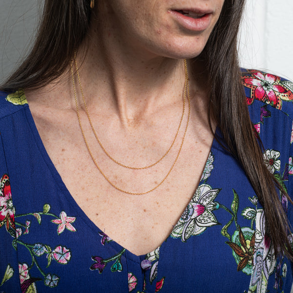 wearing layered necklaces