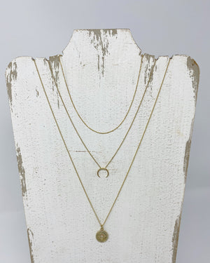 Gold necklace layering
