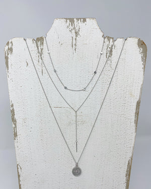 Silver necklace layering