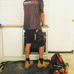 Electrician on a TIDY TRADIE work mat