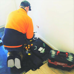 Sparky wearing Cleanboot covers and  using a TIDY TRADIE Work Mat