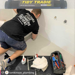 Tidy plumber and his work mat