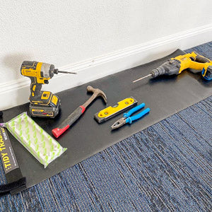 Electricians tools placed on top of a small tidy tradie work mat