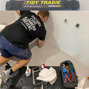 Professional plumber keeping his tools on a small tidy tradie work mat
