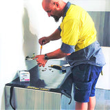An electrician protecting joinery with a tidy tradie work mat.