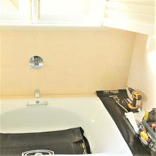 Load image into Gallery viewer, A carpenter protecting a bathtub by placing his tools on a rubber tidy tradie work mat.