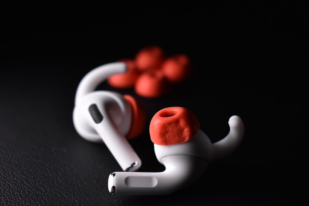Image featuring Red memory foam ear tips with AirPods Pro. Example photo showing how to control the exposure.