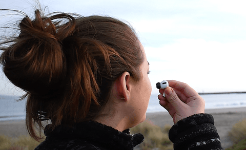Images of women inserting AirTips Pro Memory Foam Ear Replacement Tips for AirPods Pro at San Francisco beach.