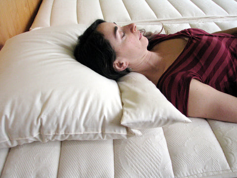 woman laying on Neck Pillow and Wool-Filled Pillow
