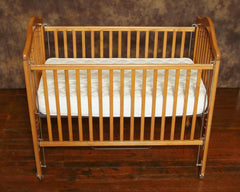 Spring natural crib mattress used in crib with slat foundation.